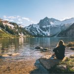 Colorado mountains with lake and person sitting down
